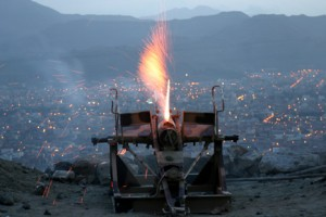 Cannon fires from Noqum mountain on the first day of the Muslim month of Ramadan