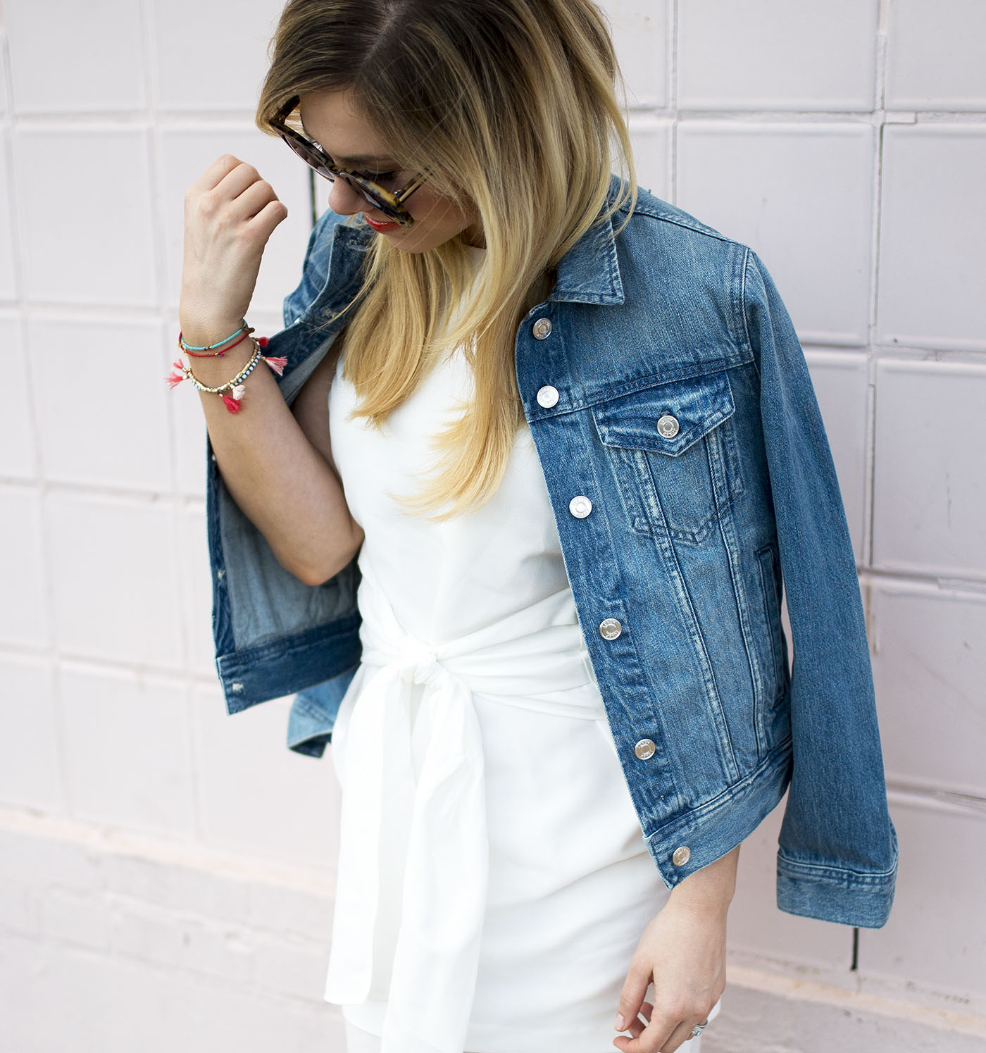 denim-jacket-over-shoulders-white-tie-at-waist-dress