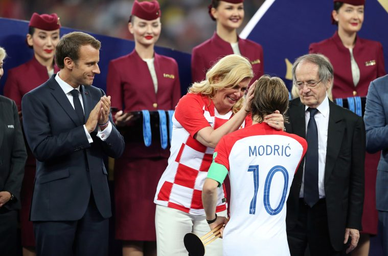 Soccer Football - World Cup - Final - France v Croatia - Luzhniki Stadium, Moscow, Russia - July 15, 2018   Croatia President Kolinda Grabar-Kitarovic speaks with Croatia's Luka Modric while President of France Emmanuel Macron looks on during the presentation              REUTERS/Carl Recine