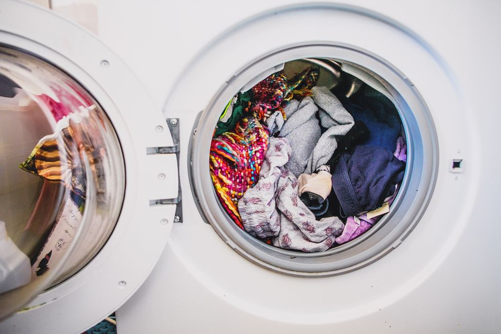 laundry-day-washing-machine-full-of-colorful-royalty-free-image-948471234-1559680181