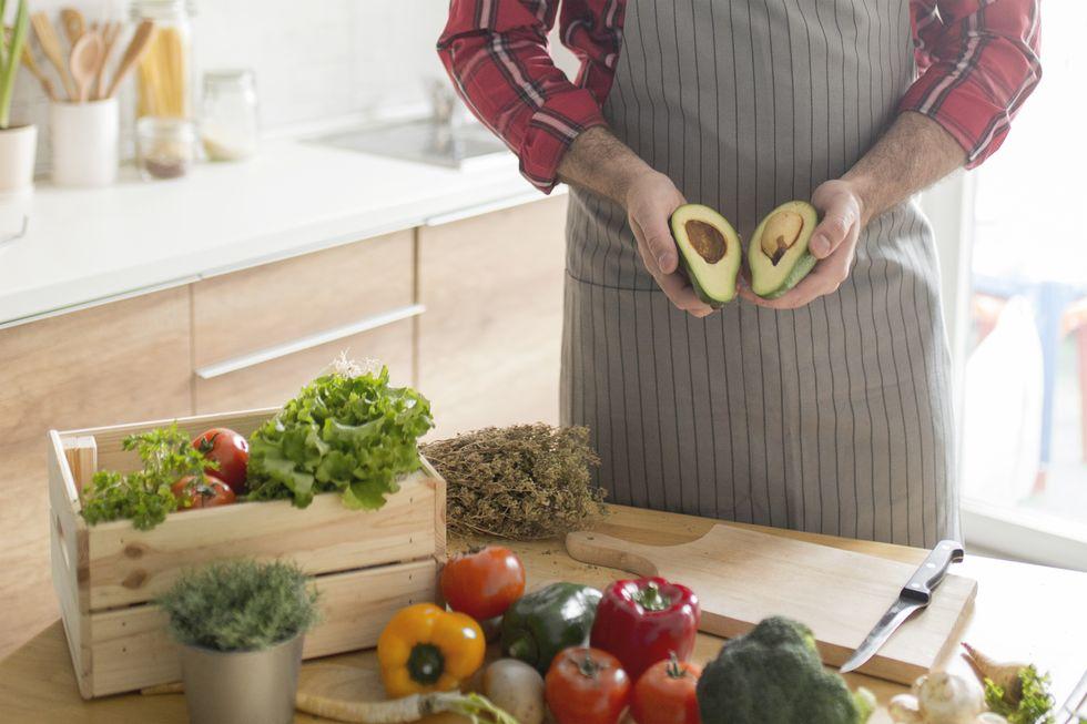 man-preparing-vegan-meal-with-avocado-royalty-free-image-1000163974-1559679220