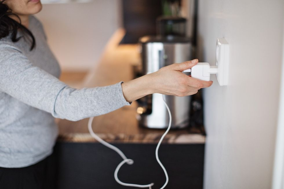 midsection-of-woman-plugging-mobile-phone-charger-royalty-free-image-975814042-1559678807