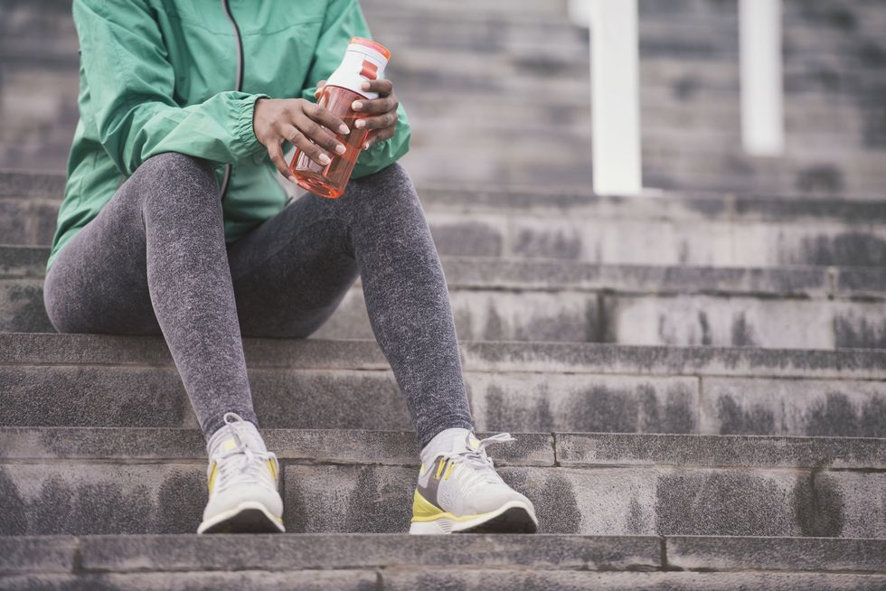 unrecognisable-athletic-woman-on-drinking-break-royalty-free-image-844046144-1559678740
