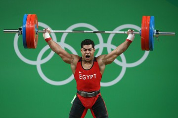 RIO DE JANEIRO, BRAZIL - AUGUST 10:  Mohamed Mahmoud of Egypt lifts during the Men's 77kg Group A weightlifting contest on Day 5 of the Rio 2016 Olympic Games at Riocentro - Pavilion 2 on August 10, 2016 in Rio de Janeiro, Brazil.  (Photo by Julian Finney/Getty Images)