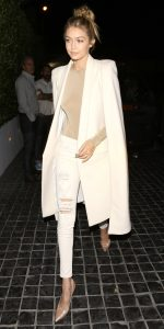 West Hollywood, CA - Gigi Hadid flashes a smile as she arrives for a dinner party with her Kardashian friends at Cecconi's in West Hollywood. The 20-year-old model looked classy in a white coat over a beige top, ripped skinny white jeans and a pair of nude high heels.  AKM-GSI         November 19, 2015  To License These Photos, Please Contact :  Steve Ginsburg (310) 505-8447 (323) 423-9397 steve@akmgsi.com sales@akmgsi.com  or  Maria Buda (917) 242-1505 mbuda@akmgsi.com ginsburgspalyinc@gmail.com
